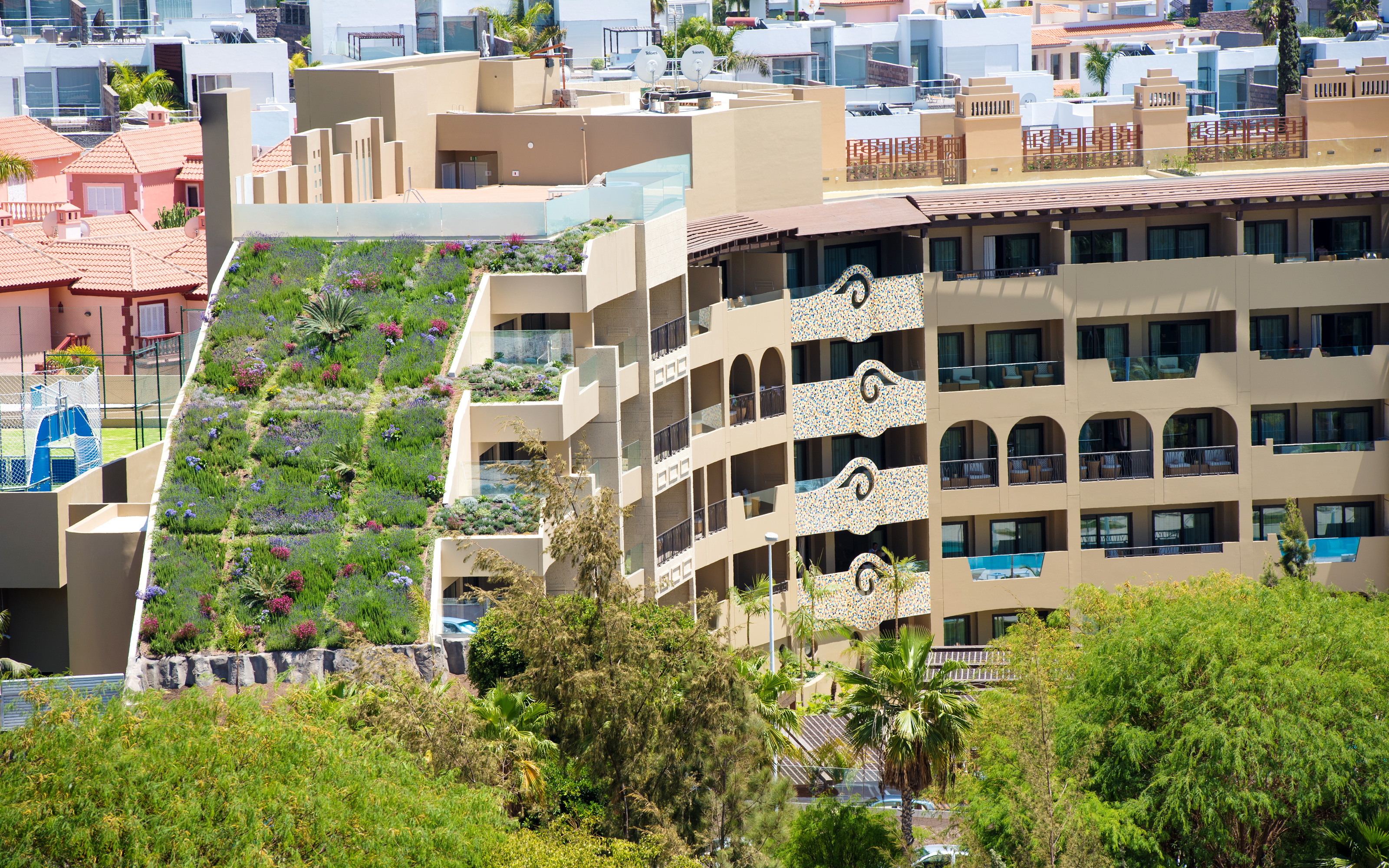 Hotel building with steep pitched green roof