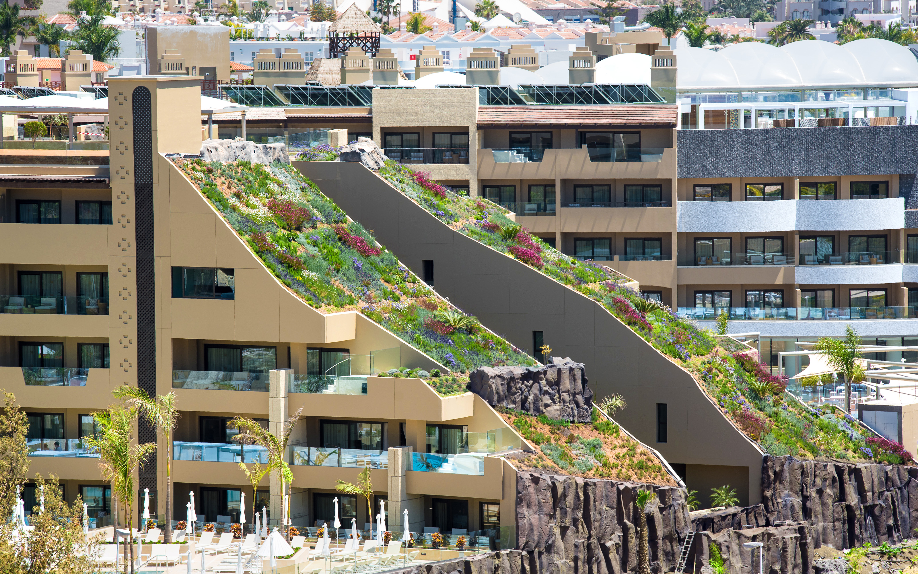 Hotel building with two steep pitched green roofs
