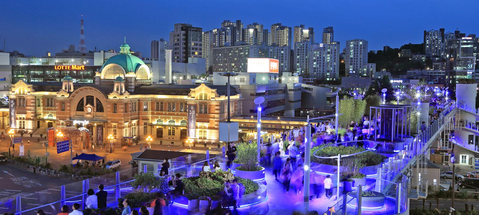 Illuminated roof garden in the city at night