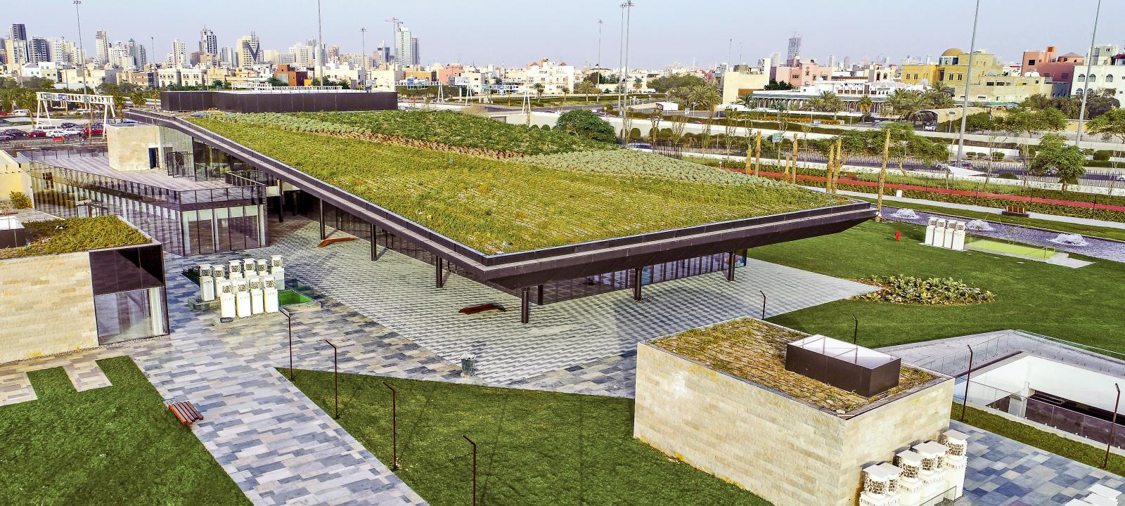 Green roofs in a park with walkways and lawn