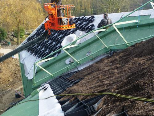 Materials for the green roof system build-up are lifted onto the roof