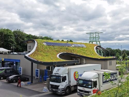 Curving green roof of a motorway service station
