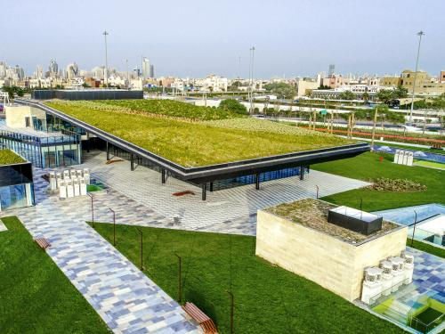 Pitched green roof, surrounded by lawn an walkways