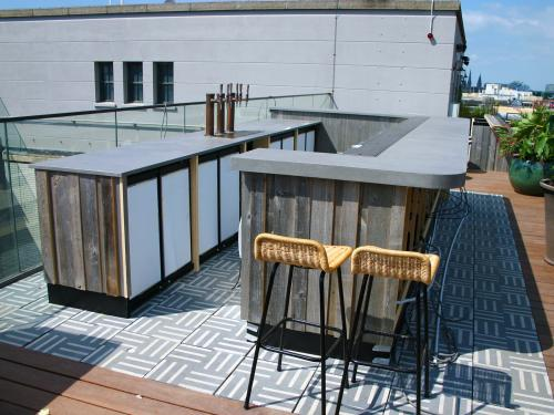 Roof terrace with a bar