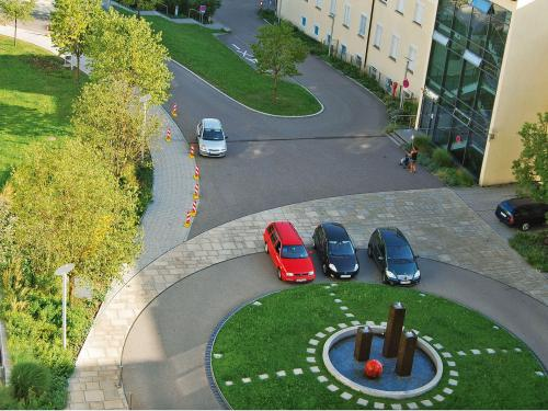 Roundabout with lawn and water feature