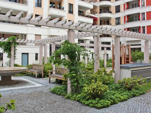 Courtyard with water feature, benches and trellis with climbing plants