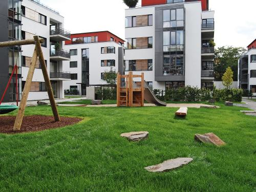 Residential complex with lawn and playground