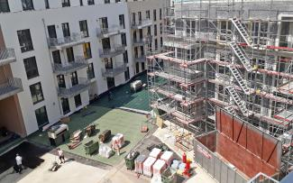 The waterproof membrane is fitted in a courtyard.