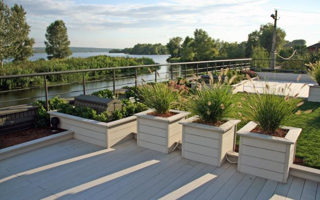 Roof garden with lawn, planters and wooden terrace decking