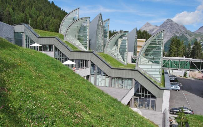 Pitched green roof with lawn and sail-shaped skylights